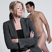 young couple sullen with man naked in studio on isolated grey background
