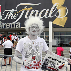 Jun 21, 2012; Miami, FL, USA; Miami Heat fan Nesdor Vazquez outside American Airlines Arena before game five in the 2012 NBA Finals against the Oklahoma City Thunder. Mandatory Credit: Derick E. Hingle-US PRESSWIRE