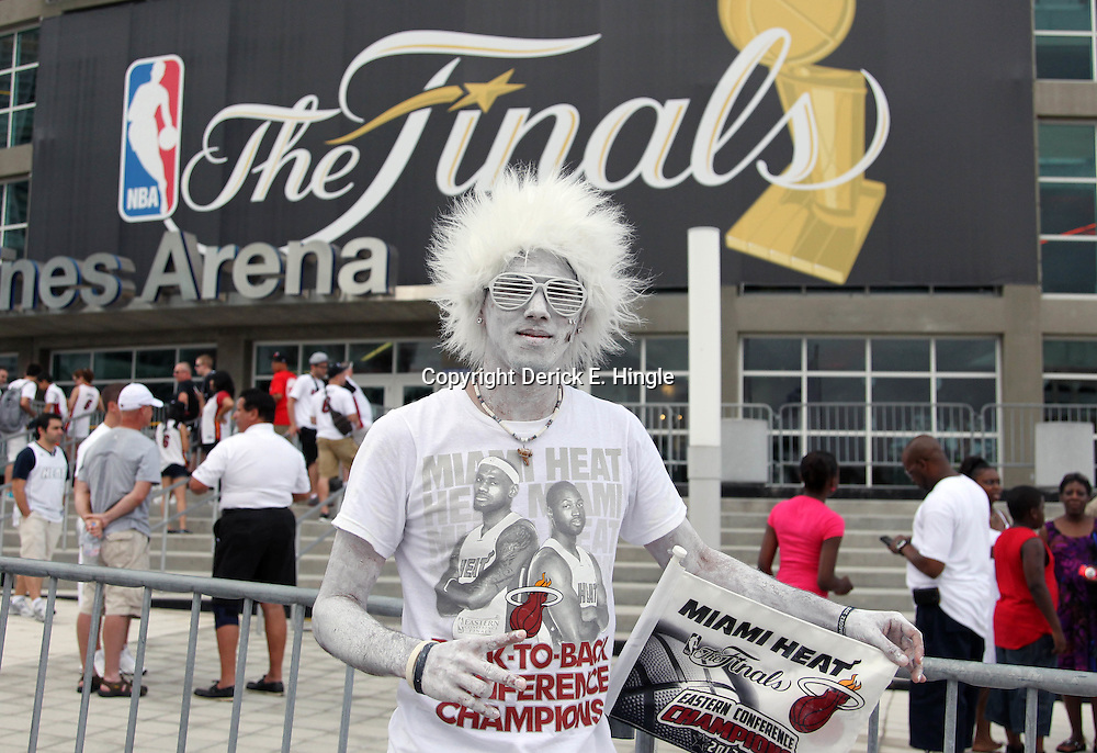 Jun 21, 2012; Miami, FL, USA; Miami Heat fan Nesdor Vazquez outside American Airlines Arena before game five in the 2012 NBA Finals against the Oklahoma City Thunder. Mandatory Credit: Derick E. Hingle-US PRESSWIRE