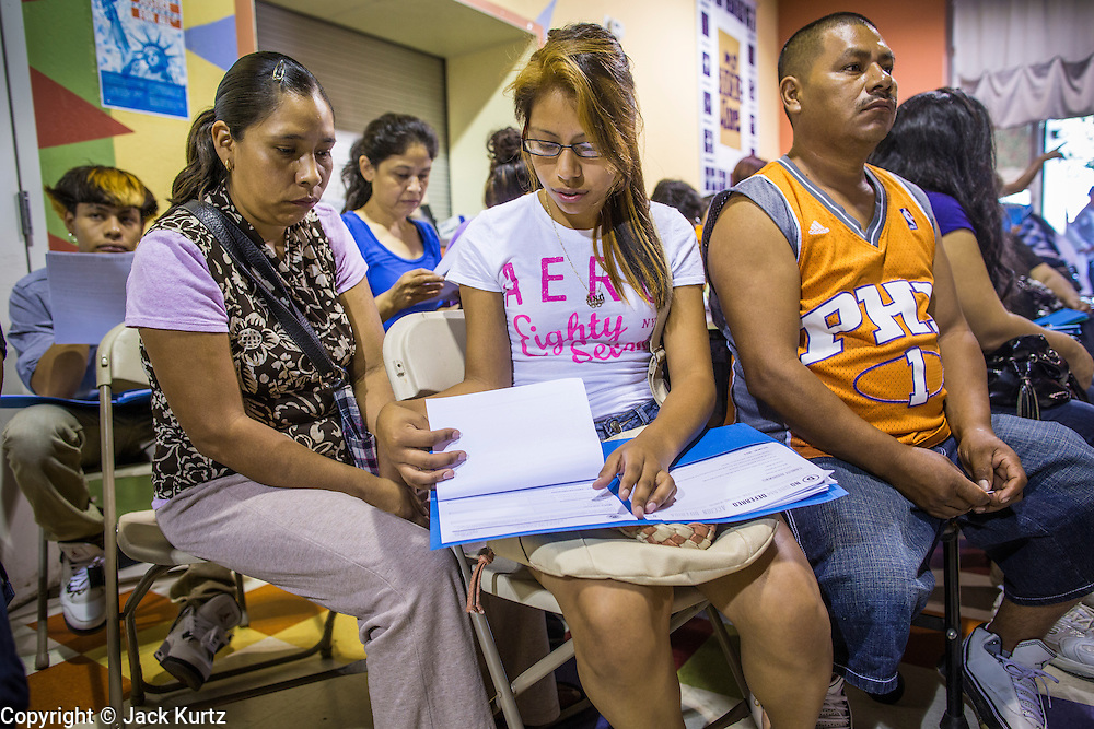 "18 AUGUST 2012 - PHOENIX, AZ:  A woman and her daughter go over the paper required to apply for the ""deferred action"" program during a deferred action workshop in Phoenix. More than 1000 people attended a series of 90 minute workshops in Phoenix Saturday on the ""deferred action"" announced by President Obama in June. Under the plan, young people brought to the US without papers, would under certain circumstances, not be subject to deportation. The plan mirrors some aspects the DREAM Act (acronym for Development, Relief, and Education for Alien Minors), that immigration advocates have sought for years. The workshops were sponsored by No DREAM Deferred Coalition.  PHOTO BY JACK KURTZ"