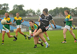 Sligo's Katie Walsh gets her shot away despite the block of Leitrim's Sharon Kerrigan during the Connacht Intermediate final in McHale Park on sunday last.<br /> Pic Conor McKeown