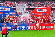 Charlton Athletic celebrate winning the play off with champagne during the EFL Sky Bet League 1 play off final match between Charlton Athletic and Sunderland at Wembley Stadium, London, England on 26 May 2019.