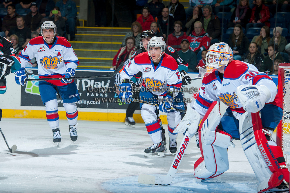 KELOWNA, CANADA - NOVEMBER 9:  Riley Kieser #14 and Ashton Sautner #5 of the Edmonton Oil Kings keep their eye on the play at the Kelowna Rockets on November 9, 2013 at Prospera Place in Kelowna, British Columbia, Canada.   (Photo by Marissa Baecker/Shoot the Breeze)  ***  Local Caption  ***
