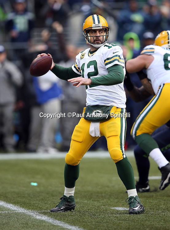 Green Bay Packers quarterback Aaron Rodgers (12) throws a pass during the NFL week 20 NFC Championship football game against the Seattle Seahawks on Sunday, Jan. 18, 2015 in Seattle. The Seahawks won the game 28-22 in overtime. ©Paul Anthony Spinelli