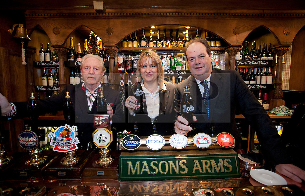 © Licensed to London News Pictures. 06/12/2012. London, UK. Road Safety Minister, Stephen Hammond (R), is seen with Coca Cola representative Kerry Roberts (C) and pub land lord Kieron Murphy (L) at the launch of the 2012 Designated Drivers Campaign in the Mason's Arms Pub in London today (06/12/12). The campaign, aimed at providing free non-alcoholic drinks for designated drivers, is sponsored by soft drinks company Coca Cola and runs from 6-31 December 2012.    Photo credit: Matt Cetti-Roberts/LNP