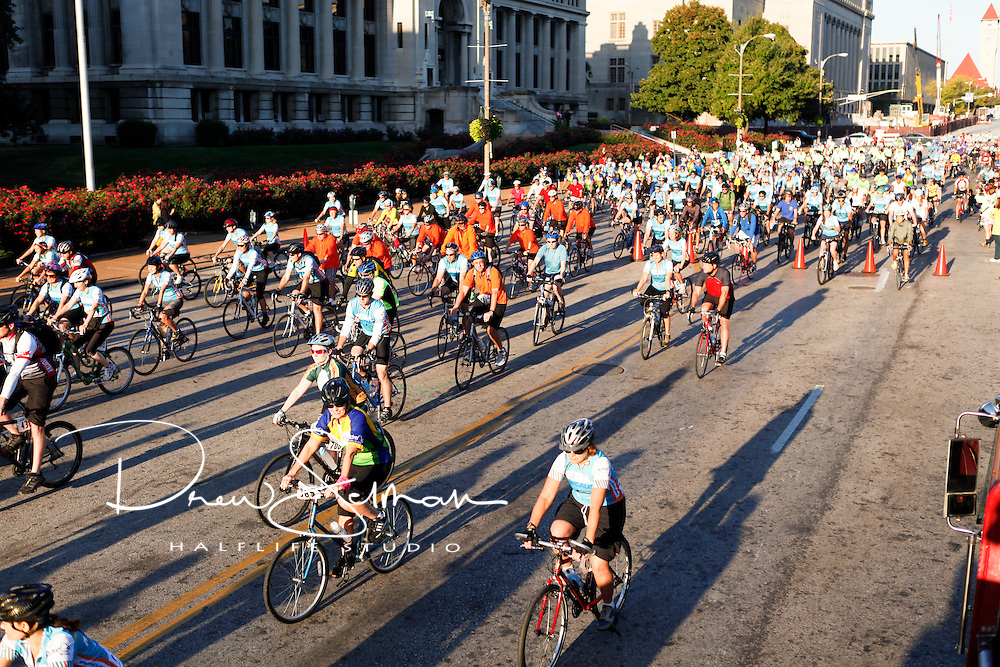 9-OCT-2010 -- ST LOUIS - Over 700 cyclists start the Pedal the Cause ride through St Louis.   The start of the 700 riders took just about 3 minutes to complete. Pedal the Cause is an annual cycling event that seeks to provide and direct net funding for cancer research, cancer discovery grants and clinical translational care on best ideas not currently eligible for federal funds.  With 100% of donations remaining in St. Louis, the event was started by Bill Koman, a St Louis business man and himself a cancer survivor.