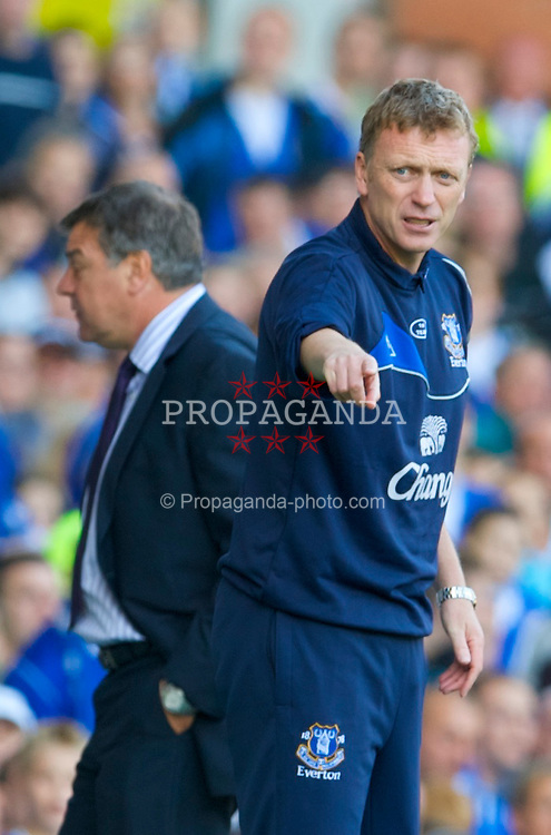 LIVERPOOL, ENGLAND - Sunday, September 20, 2009: Everton's manager David Moyes and Blackburn Rovers' manager Sam Allardyce during the Premiership match at Goodison Park. (Pic by David Rawcliffe/Propaganda)
