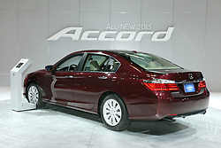 08  February 2013: 2013 Honda Accord. Chicago Auto Show, Chicago Automobile Trade Association (CATA), McCormick Place, Chicago Illinois<br /> <br /> 2013 HONDA ACCORD: On display at the 105th Chicago Auto Show is the all-new 2013 Accord Sedan and Accord Coupe, which is the ninth generation of Honda's best-selling midsize car. Fully redesigned for '13, the Accord is slightly more compact than the prior-generation, yet provides improvements in rear legroom and trunk volume. The latest Accord lineup includes LX, Sport, EX/EX-L V-6 and Touring, all offering a more luxurious five-passenger automobile, with better performance and features than any other model in the Accord's 37-year history. Standard items include Bluetooth HandsFreeLink, USB/iPod integration, rearview camera, an audio/information screen, Eco Assist driving system, Pandora Internet radio integration and an SMS text messaging function. The 2013 Accord lineup is powered by Honda's new Earth Dream powertrains, which includes the next-generation 2.4 liter direct-injected VTEC four-cylinder engine, with 185 and 189 horsepower ratings. The 2013 models also offer a more efficient and powerful ( 245hp) Earth Dreams VTEC V-6. Three transmissions are available, including the first-ever application of a continuously variable transmission (CVT) on 2.4L four-cylinder models; a six-speed automatic on V-6 models, and six-speed manual transmissions on 2.4L four-cylinder models and the 3.5L V-6 Coupe. New to the lineup is the 2014 Accord Plug-in Hybrid Sedan and a second model with conventional hybrid based on the same powertrain architecture. The trunk on the Coupe can carry 13.7 cubic feet of luggage, and the Sedan increases the volume to 15.8 cubic feet.