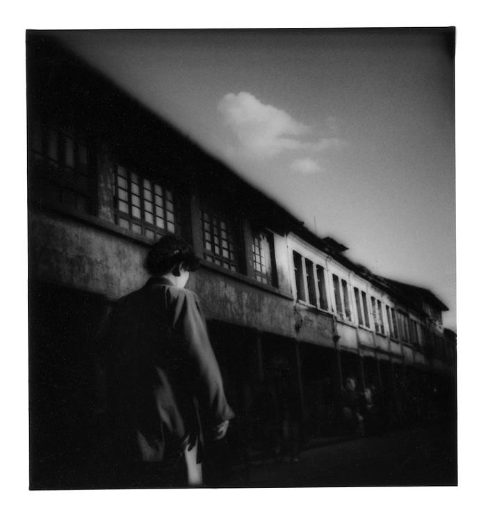 Woman passing a cloud, Kunming, Yunnan, China.  1997