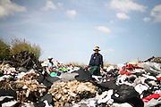 Mae Sot, Tak, Thailand - <br /> <br /> 'City Of Garbage' In Thailand<br /> <br /> Father and son looking for clothes at the Mae Sot garbage dump. Tingkaya also known as the City Of Garbage an area roughly the size of a football stadium The poor inhabitants make a living selling recyclable materials like wire, metal, glass, plastic. They heap dwellers survive by eating left-overs and sleep in the same harsh environment which is a breeding ground for bacteria and diseases. <br /> ©Exclusivepix