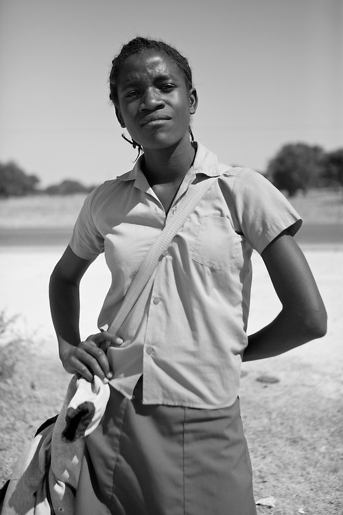 A young Ovanmbo woman in a little viallage near Oshakati, in Namibia, Africa.