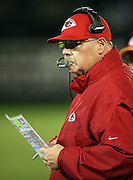 Kansas City Chiefs head coach Andy Reid holds a play chart as he looks on from the sideline during the NFL week 12 regular season football game against the Oakland Raiders on Thursday, Nov. 20, 2014 in Oakland, Calif. The Raiders won their first game of the season 24-20. ©Paul Anthony Spinelli