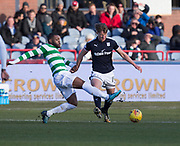 26th December 2017, Dens Park, Dundee, Scotland; Scottish Premier League football, Dundee versus Celtic; Dundee's Mark O'Hara is tackled by Celtic's Olivier Ntcham