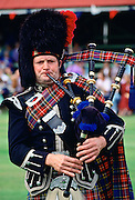 Bagpipe player at the Braemar Games, Scotland