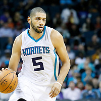03 November 2015: Charlotte Hornets forward Nicolas Batum (5) brings the ball up court during the Charlotte Hornets  130-105 victory over the Chicago Bulls, at the Time Warner Cable Arena, in Charlotte, North Carolina, USA.