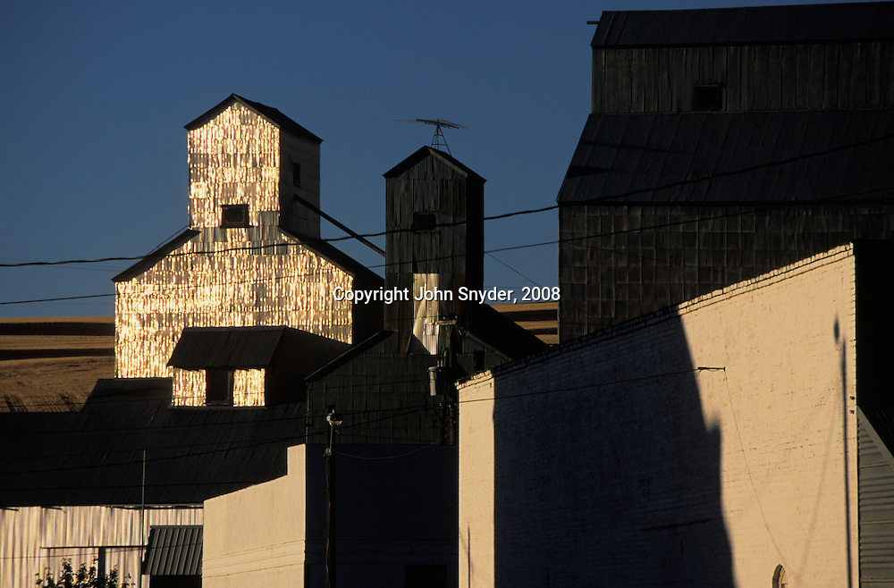 Sun reflects off of grain elevators in St. John Washington in Eastern Washington. The Palouse region, comprising 4000 square miles of wind-deposited hills in Eastern Washington and Northern Idaho, is one of the most productive dry-farming regions of the world, boasting bountiful harvests of wheat, peas, and lentils..