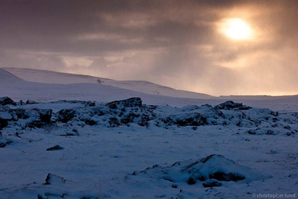 Winter mood at Hellisheiði, Iceland. Dramatic winterlight and sky.