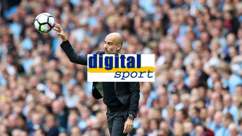 Football - Pep Guardiola of Manchester City during the match at the Etihad Stadium between Manchester City and West Ham United. <br /> <br /> 2016 / 2017 Premier League - Manchester City vs. West Ham United<br /> <br /> -- at The Etihad Stadium.<br /> <br /> COLORSPORT/LYNNE CAMERON