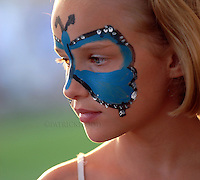 Grace Tollard, 10, of Fond du Lac, hangs out in the face painting tent at the Fondy high school track during the Fond du Lac Relay for event. Friday, August, 3, 2012. Patrick Flood/The Reporter.