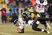 James Harrison (92) of the Pittsburgh Steelers sacks Joe Flacco (5) of the Baltimore Ravens in the AFC Divisional Playoff game on Jan. 15, 2011 at Heinz Field in Pittsburgh, Pennsylvania. The Steelers won 31-24. (Photo by Joe Robbins)