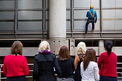 © licensed to London News Pictures. London, UK 14/05/2014. City traders and business people watching their colleagues abseil off the Lloyd's building to raise funds for London-based international charity 'RedR' on Wednesday, 14 May 2014. Photo credit: Tolga Akmen/LNP