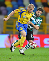 20091105: LISBON, PORTUGAL - Sporting Lisbon vs Ventspils: Europa League 2009/2010 - Group Stage. In picture: Grigori Chirkin (VENT) and Miguel Veloso (SPO). PHOTO: Alexandre Pona/CITYFILES