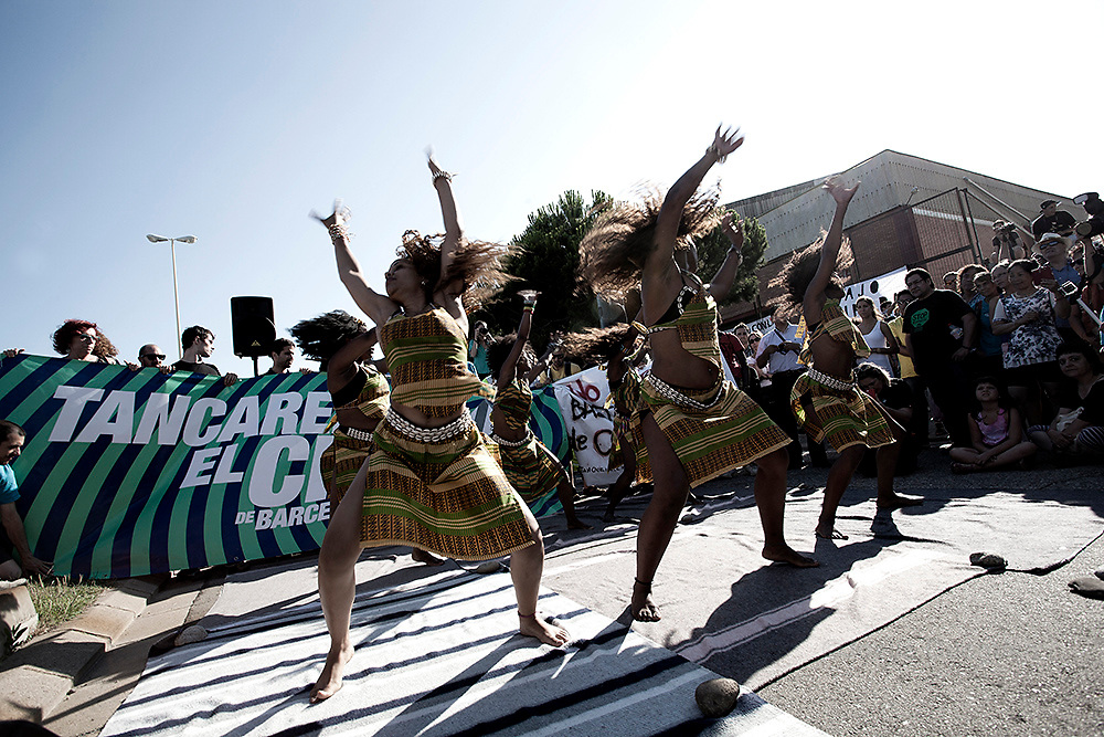 "A group of young women perform African traditional dances in support of the protest  organized by""Tancarem el CIE"" to get to government to close the Immigration detention center permanently.   Barcelona 20/06/2015"