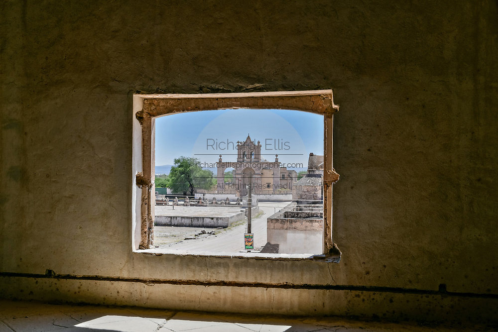A view of the Moncado Burial Chapel from inside a crumbling room at the fading Hacienda de Jaral de Berrio in Jaral de Berrios, Guanajuato, Mexico. The abandoned Jaral de Berrio hacienda was once the largest in Mexico and housed over 6,000 people on the property and is credited with creating Mescal.
