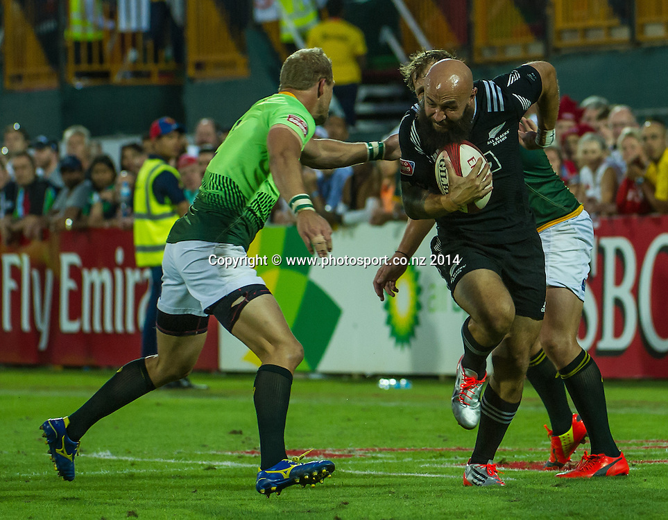 DJ Forbes of New Zealand is tackled by Philip Snyman of South African in the Cup Semi Final of the IRB Sevens World Series rugby tournament at the Emirates Airline Dubai Rugby Sevens in Dubai, UAE, on Saturday, Dec. 6th, 2014. Photo by: Stephen Hindley/Sportdxb/Photosport