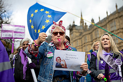 """© Licensed to London News Pictures. 13/03/2019. London, UK. A """"Women Against State Pension Inequality"""" (WASPI) protester rallies outside Parliament as The Chancellor of The Exchequer Philip Hammond delivers the Spring Statement. The WASPI campaign is seeking compensation for women who were affected when the state pension age for men and women was equalised. Photo credit: Rob Pinney/LNP"""