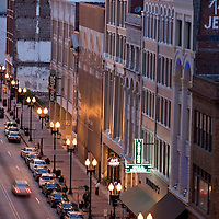 Streetlights illuminate buildings along Gay Street in downtown Knoxville, Tennessee.