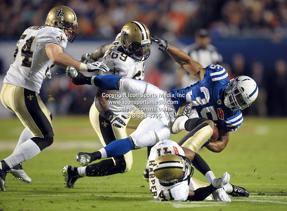 Feb. 07, 2010 - Miami Gardens, FL - Florida, USA - United States ---   Indianapolis Colts running back Chad Simpson is tripped up by New Orleans Saints Roman Harper during the second quarter of Super Bowl XLIV at Sun Life Stadium
