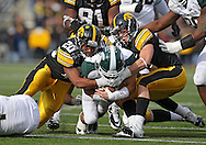 November 12, 2011: Michigan State Spartans wide receiver Brad Sonntag (81) is brought down by Iowa Hawkeyes linebacker Christian Kirksey (20) and Iowa Hawkeyes defensive back Tanner Miller (5) during the second half of the NCAA football game between the Michigan State Spartans and the Iowa Hawkeyes at Kinnick Stadium in Iowa City, Iowa on Saturday, November 12, 2011. Michigan State defeated Iowa 37-21.