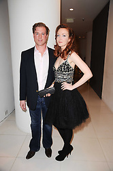 OLIVIA GRANT and    at a party to celebrate Lancome's 10th anniversary of sponsorship of the BAFTA's in association with Harper's Bazaar magazine held at St.Martin's Lane Hotel, London on 19th February 2010.