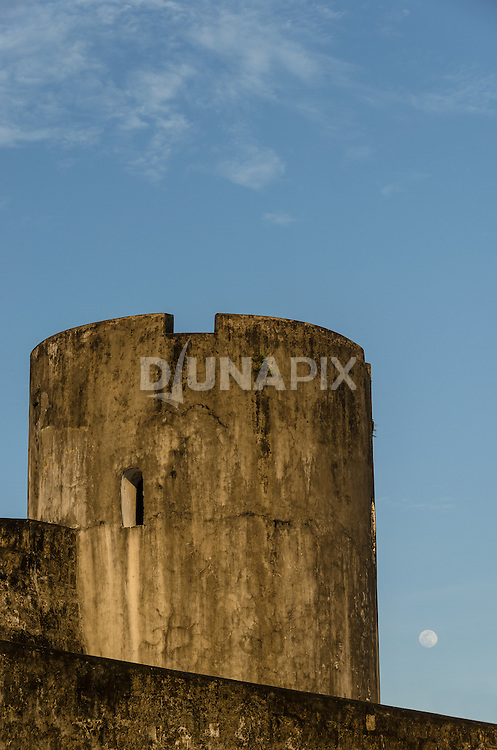 A nearly full moon rises behind a watch tower at Fort Belgica, Banda Neira.