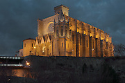 The Colegiata Basilica de Santa Maria, or Collegiate Basilica of Santa Maria, also known as La Seu, built in Gothic style by Berenguer de Montagut, from 1328 until 1486, around an existing 11th century Romanesque church, on the Puigcardener above the Cardener river, Manresa, Catalonia, Spain. The exterior is striking with 18 double flying buttresses and the basilica holds many important Gothic altarpieces, including the Altarpiece of St Mark by Arnau Bassa, 1346, Altarpiece of the Holy Spirit by Pere Serra, 1394, Altarpiece of St Michael and St Nicholas by Jaume Cabrera, 1406, Altarpiece of the Holy Trinity by Antoni Marques, 1506-1507. Picture by Manuel Cohen
