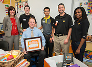 "Fourth-grade teacher Robert Bonn in his classroom at Twain Elementary, October 1, 2013. Bonn was awarded school supplies valued at $1000 by OfficeMax as part of the ""A Day Made Better"" program."