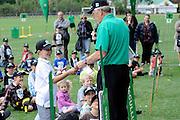 Cricket fan accepts his prize at the National Bank's Cricket Super Camp , University oval, Dunedin, New Zealand. Thursday 2 February 2012 . Photo: Richard Hood photosport.co.nz