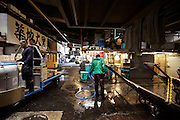 end of day, sorting and distribution area at Tsukiji Wholesale Fish Market,  Tokyo, Japan.