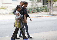 President Barack Obama walks from St John's Episcopal Church to the White House on October 28, 2012 (left to right, Sasha Obama, President Obama, Malia Obama). Dennis Brack...