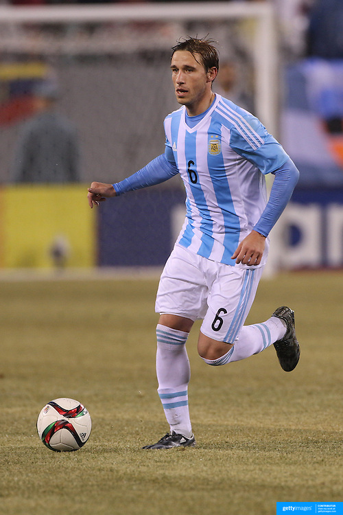 Lucas Biglia, Argentina, in action during the Argentina Vs Ecuador International friendly football match at MetLife Stadium, New Jersey. USA. 31st march 2015. Photo Tim Clayton