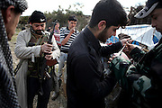 Members of the Free Syrian Army doing a check on their Weapons in the morning near Al Janoudiyah, Province of Idlib, Syria.