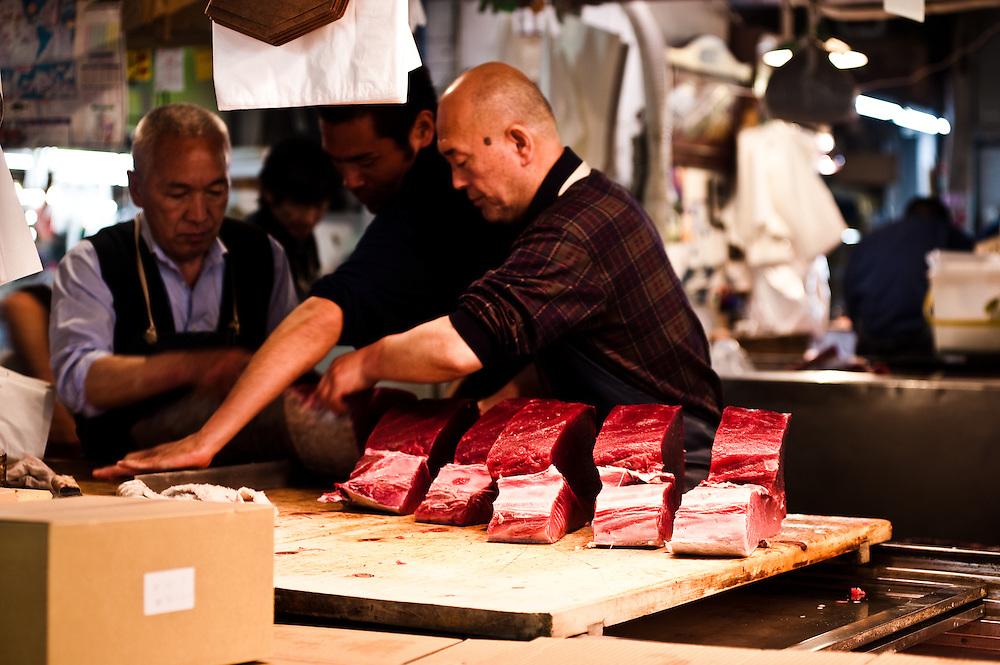 Cutting fresh tuna with a maguro bocho (tuna knife), Tsukiji Fish Market, Tokyo, Japan