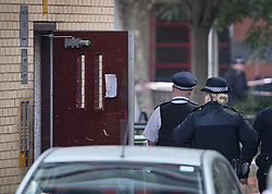 © Licensed to London News Pictures. 18/10/2018. London, UK. Police stand at the entrance to flats on the Doddington estate in Battersea after a man in his 40's died after an alleged assault. Police were called at around 5. 30pm to reports of several males fighting. Photo credit: Peter Macdiarmid/LNP