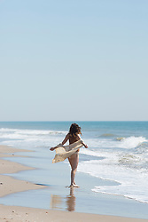 Back view of Woman Walking on Beach