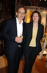 Millionairess SIGRID RAUSING and her husband ERIC ABRAHAM at a party to celebrate the publication of 'Last Voyage of The Valentina' by Santa Montefiore at Asprey, 169 New Bond Street, London W1 on 12th April 2005.<br /><br />NON EXCLUSIVE - WORLD RIGHTS