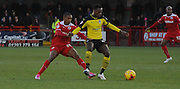 Lewis Young and Gavin massey battling for posession during the Sky Bet League 1 match between Crawley Town and Colchester United at Broadfield Stadium, Crawley, England on 28 December 2014. Photo by Michael Hulf.