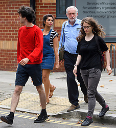 © London News Pictures. 28/07/2016. London, UK. Labour Party leader JEREMY CORBYN returns to his London home with a group of young supporters following a ruling at the Royal Courts of Justice which upheld a decision by the NEC to guarantee Corbyn a place on the Labour Party leadership ballot.  Photo credit: Ben Cawthra/LNP