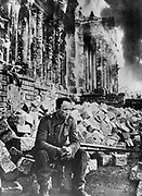 Second World War:  German soldier sits amongst the ruins of the Reichstag in Berlin after the Russian army entered  the city in 1945