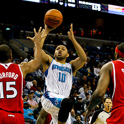 Jan 1, 2013; New Orleans, LA, USA; New Orleans Hornets shooting guard Eric Gordon (10) shoots over Atlanta Hawks center Al Horford (15) and small forward Josh Smith (5) during the second quarter of a game at the New Orleans Arena. Mandatory Credit: Derick E. Hingle-USA TODAY Sports